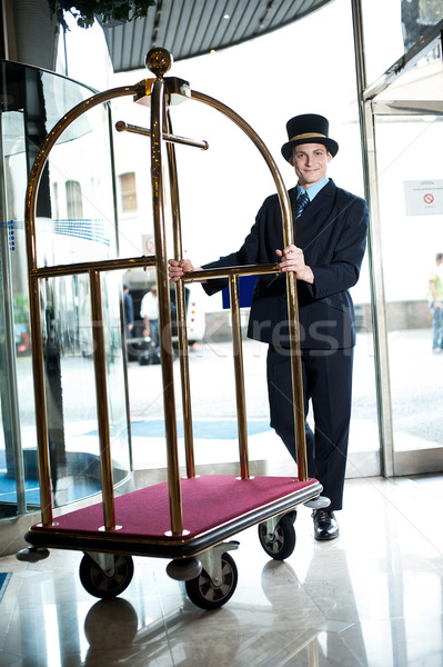 Profile shot of a doorman holding a cart Stock photo © stockyimages