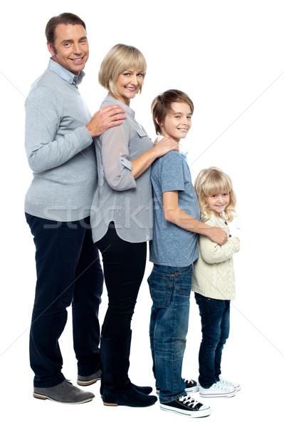 Семейный портрет четыре Постоянный линия образование Сток-фото © stockyimages