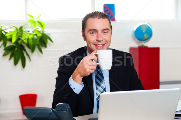 Boss enjoying hot coffee during work break Stock photo © stockyimages