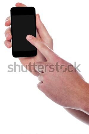 человека указывая смартфон отображения изображение парень Сток-фото © stockyimages