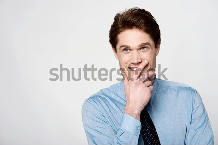 Young male executive posing casually Stock photo © stockyimages