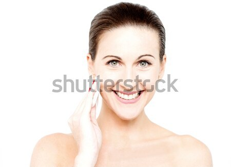 Woman cleaning her face with cotton pad Stock photo © stockyimages