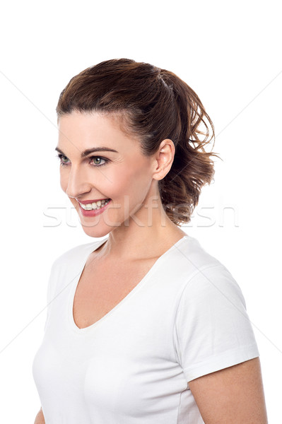 Smiling woman posing sideways.  Stock photo © stockyimages