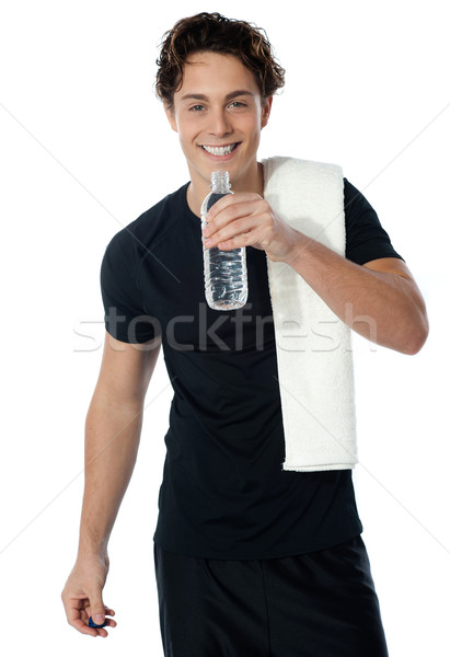 Stock photo: Fit man drinking water isolated on white