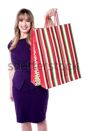 Blonde with shopping bags tossed over her shoulders Stock photo © stockyimages