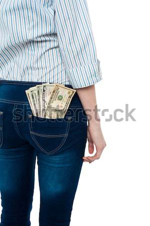 Girl carrying dollars in back pocket Stock photo © stockyimages