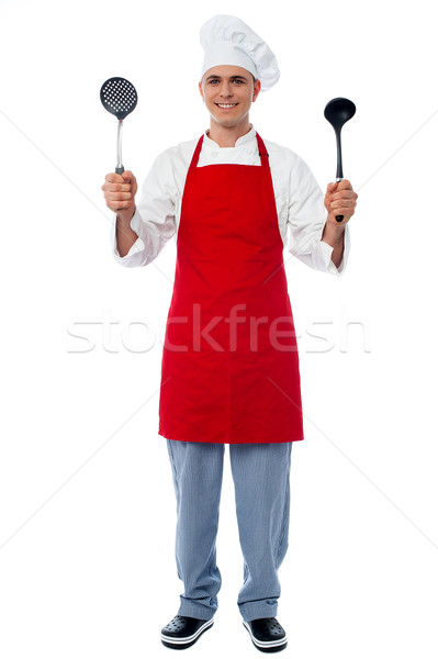 Chef holding kitchen essentials Stock photo © stockyimages