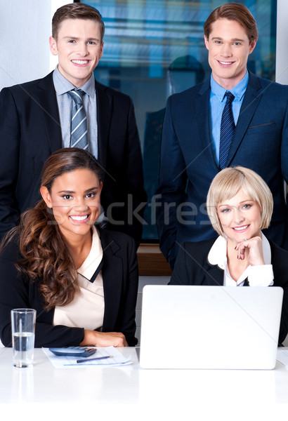 Stock photo: Corporates with businesswomen on foreground