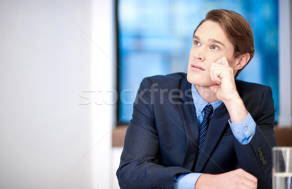Young classy businessman thinking Stock photo © stockyimages