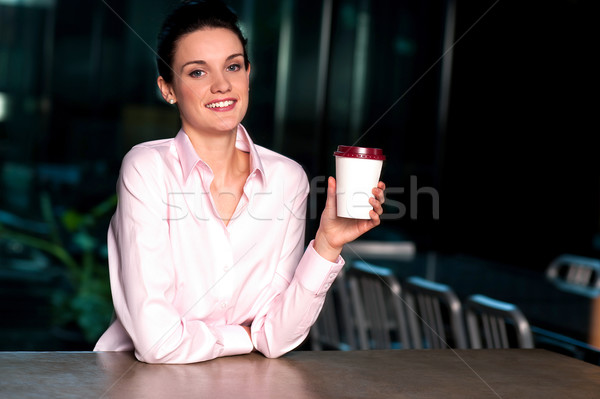 Pretty lady enjoying chilled liquid at refreshment Stock photo © stockyimages
