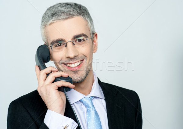 Businessman attending phone call Stock photo © stockyimages