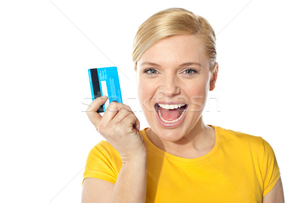 Blond sales girl posing with credit card Stock photo © stockyimages