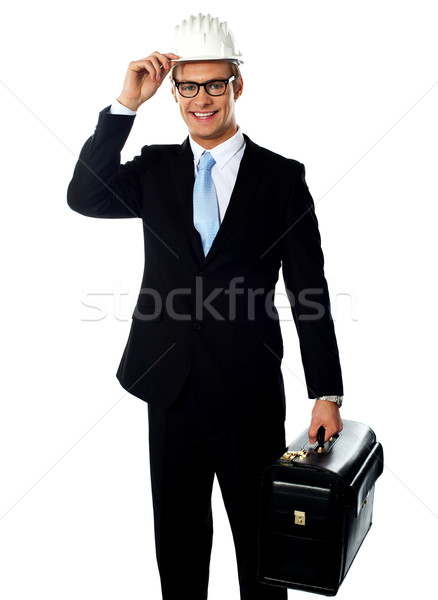 Stock photo: Handsome american architect holding a briefcase
