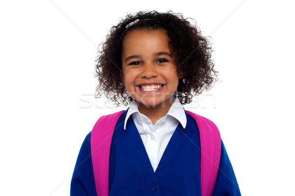 Beautiful girl in uniform with backpack smiling at you Stock photo © stockyimages