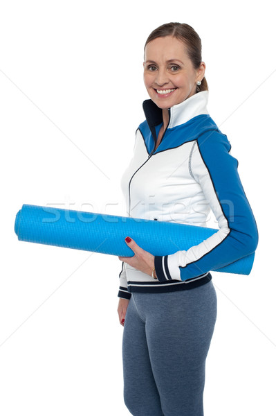 Kadın mavi yoga mat uygunluk sağlık Stok fotoğraf © stockyimages