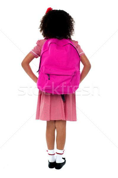 Kız karşı duvar üniforma okul Stok fotoğraf © stockyimages
