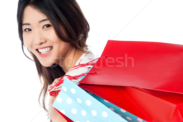 Cheerful young shopaholic girl Stock photo © stockyimages