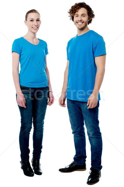 Perfect young couple posing in trendy casuals Stock photo © stockyimages