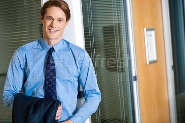 Businessman posing casually at office Stock photo © stockyimages