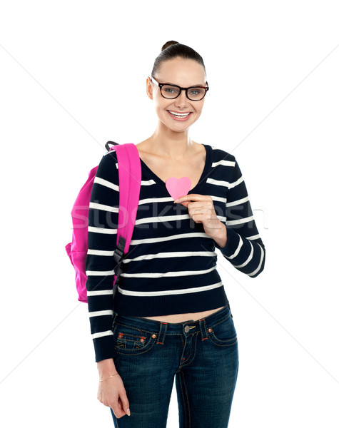 College student holding heart symbol Stock photo © stockyimages