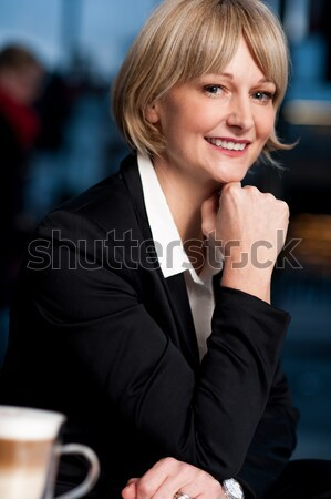Businesswoman working during her break hour Stock photo © stockyimages