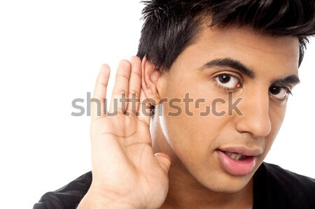 Casual young guy eavesdropping  Stock photo © stockyimages
