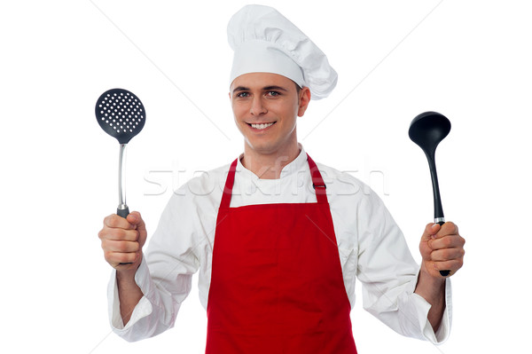 Male chef holding kitchen essentials Stock photo © stockyimages