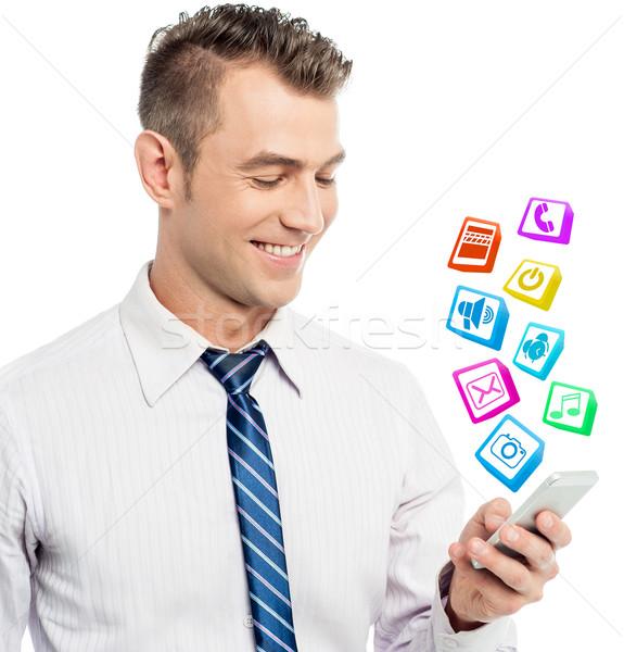 Tous favori applications téléphone homme d'affaires Photo stock © stockyimages