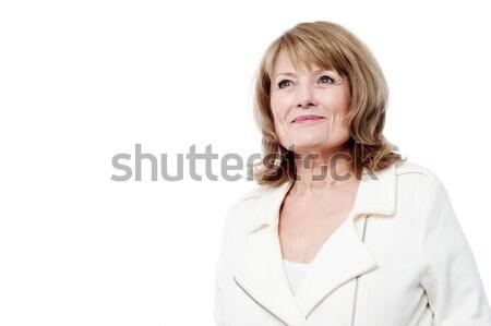 Beautiful aged woman looking upwards Stock photo © stockyimages