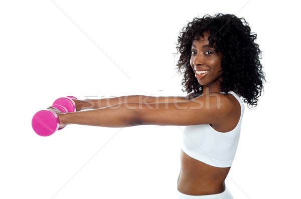 Fitness freak exercising with dumbbells Stock photo © stockyimages