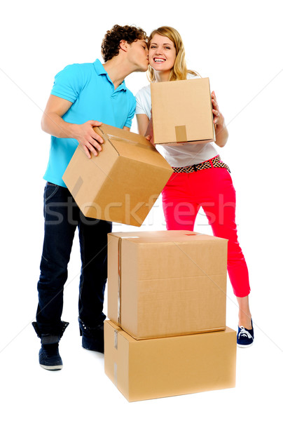 Young couple gently holding cartons Stock photo © stockyimages