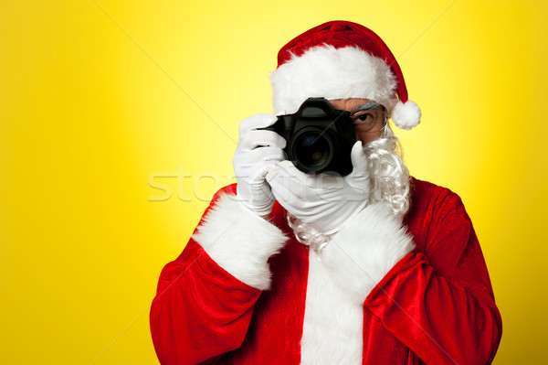 Say cheese! Santa capturing a perfect moment Stock photo © stockyimages