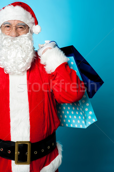 Saint Nicholas carrying colorful shopping bags Stock photo © stockyimages