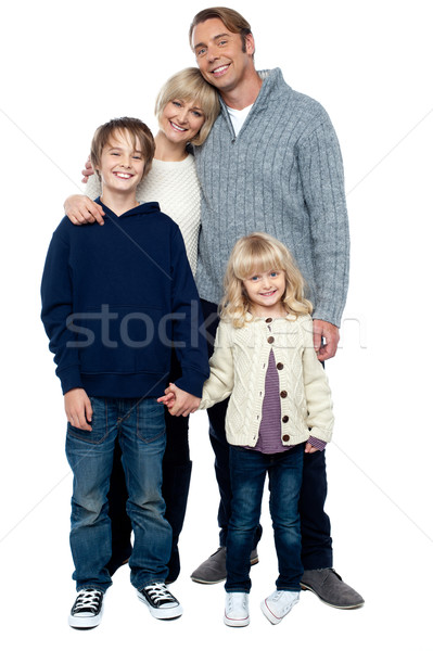 Cheerfully winter wear family of four. Stay protected Stock photo © stockyimages
