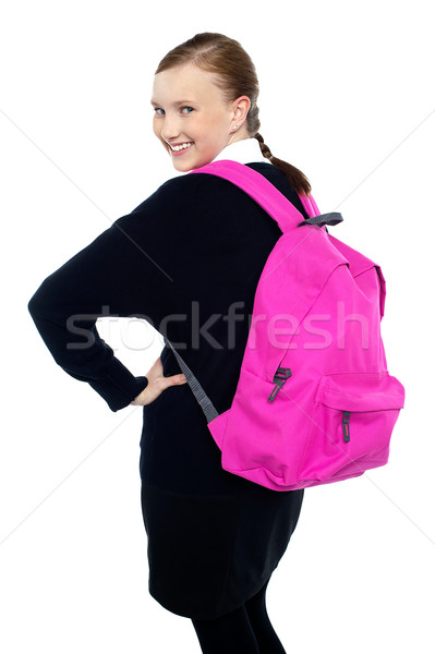 Teen girl turning back and passing smile to you Stock photo © stockyimages