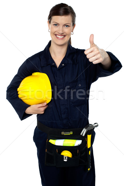 Stock photo: Woman in builder uniform showing thumbs up