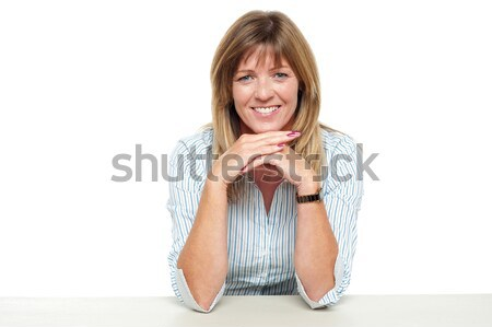 Smiling business lady sitting idle in office Stock photo © stockyimages