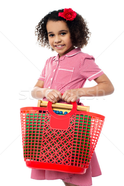 Stock photo: Pretty child carrying math equipment's in basket