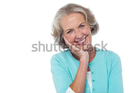 Stockfoto: Verlegen · beleefd · senior · glimlachende · vrouw · hand · wang