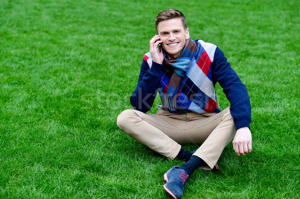 Happy young man communicating, posing outdoors Stock photo © stockyimages
