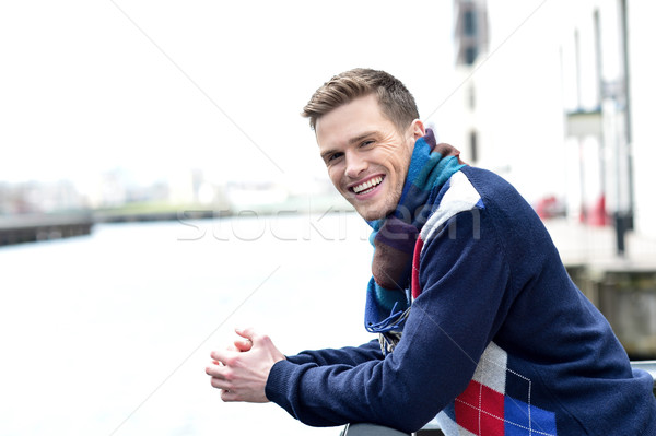 Stylish young man beside river railing Stock photo © stockyimages