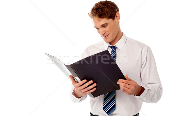 Businessman reviewing records. Stock photo © stockyimages