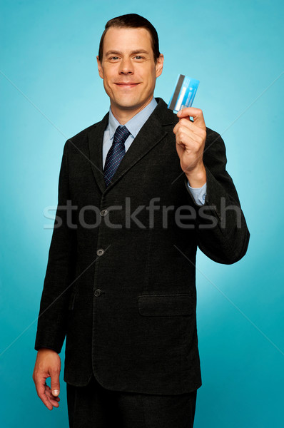 Male executive showing credit card Stock photo © stockyimages