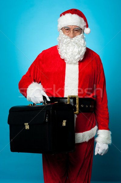 Santa is all set to visit his new office, holding briefcase Stock photo © stockyimages