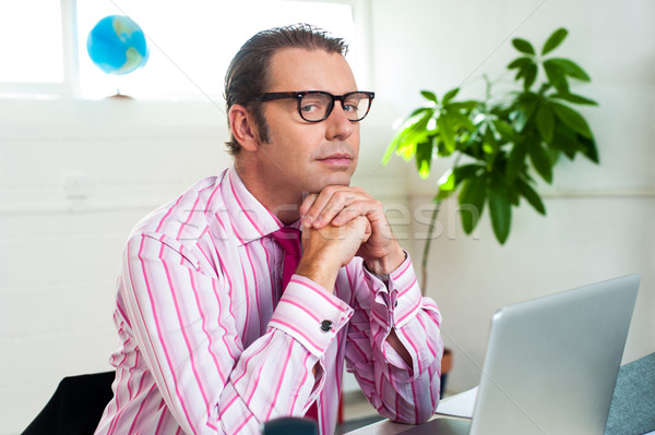 Idle corporate guy in office looking sideways Stock photo © stockyimages