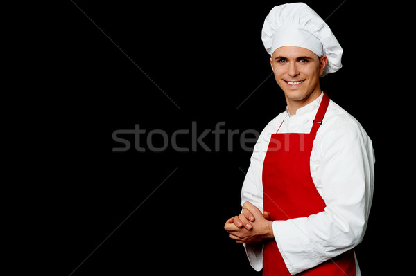 Isolated male chef over black background Stock photo © stockyimages