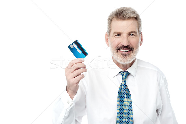 Smiling male executive showing debit card Stock photo © stockyimages