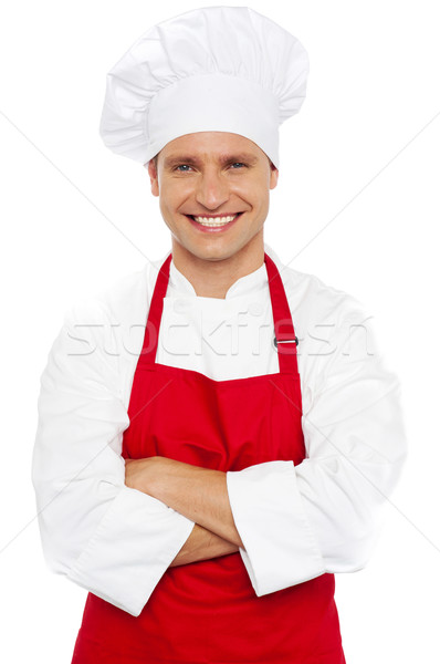 Portrait of a smiling chef with arms crossed Stock photo © stockyimages