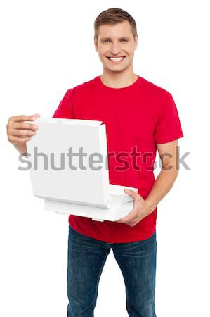 Smiling casual man holding pizza box Stock photo © stockyimages
