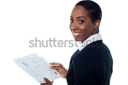 Signora punta fuori errore annuale relazione Foto d'archivio © stockyimages